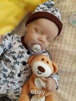 Reborn BABY 16 In takes a baby pacifier