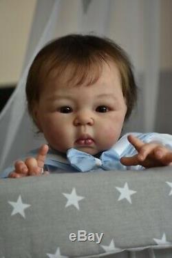 Reborn baby Suu Kyi by Adrie Stoete
