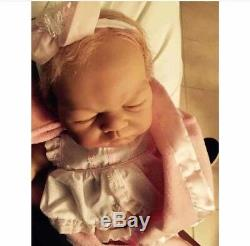 Reborn girl baby doll weighted, barely used, blonde hair